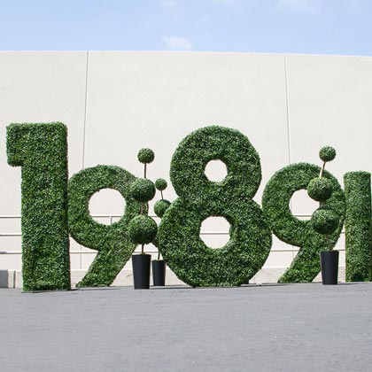 Logos, Lettering, and Custom Artificial Topiary Plants